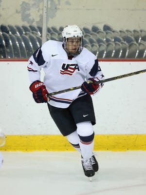 Auston Matthews #19 of USA White skates against Team Finland during the 2014 USA Hockey Junior Evaluation Camp at the Lake Placid Olympic Center on August 4, 2014 in Lake Placid, New York.