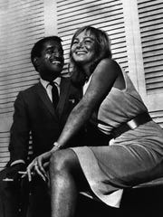 American entertainer Sammy Davis Jr., 34, and Swedish movie actress May Britt, 24, pose in a London Hotel, on June 7, 1960, after announcing they plan to marry. The five-foot-six-inch Davis and five-foot-seven actress said they would wed after her divorce from Eddie Gregson becomes final on September 28.