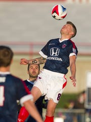 Indy Eleven midfielder Nicki Paterson (8) clears the
