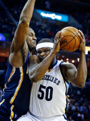 Memphis Grizzlies forward Zach Randolph (right) drives