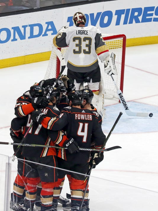 Vegas Golden Knights goalie Maxime Legace (33) clears the puck as Anaheim Ducks celebrate a goal during the second period of an NHL hockey game in Anaheim, Calif., Wednesday, Nov. 22, 2017. (AP Photo/Reed Saxon)