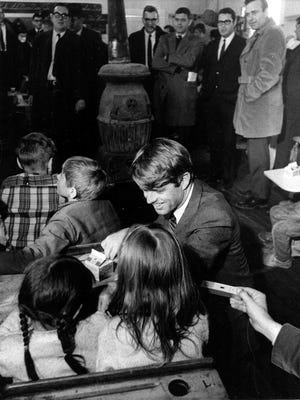 Sen. Robert F. Kennedy, D-N.Y., chats with two girls at Millers Branch School, a one-room school in Breathitt County, Ky.