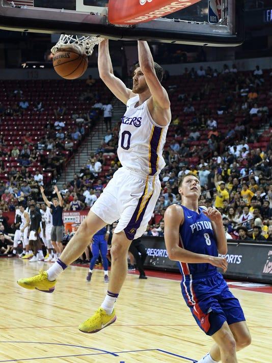 7c73c0c4ae6e Sviatoslav Mykhailiuk. Lakers guard Sviatoslav Mykhailiuk dunks ahead of  Pistons forward Henry Ellenson in a quarterfinal game of NBA summer league  ...