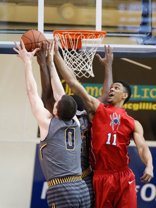 La Salle's Steve Zack, (0)  and Richmond's Terry Allen,(11) go after a rebound during the first half of an NCAA basketball game, Thursday, Feb. 5, 2015 in Philadelphia. (AP Photo/The Philadelphia Inquirer, Charles Fox)  PHIX OUT; TV OUT; MAGS OUT; NEWARK OUT