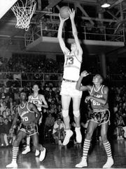 Middletown's Jerry Lucas, center, grabs a rebound in a game against Dayton Roosevelt during his junior year in 1956. He led the Middies to back-to-back state titles and a 76-game winning streak before Columbus North pulled a 63-62 upset in the Final Four his senior year, the biggest upset in state tournament history.