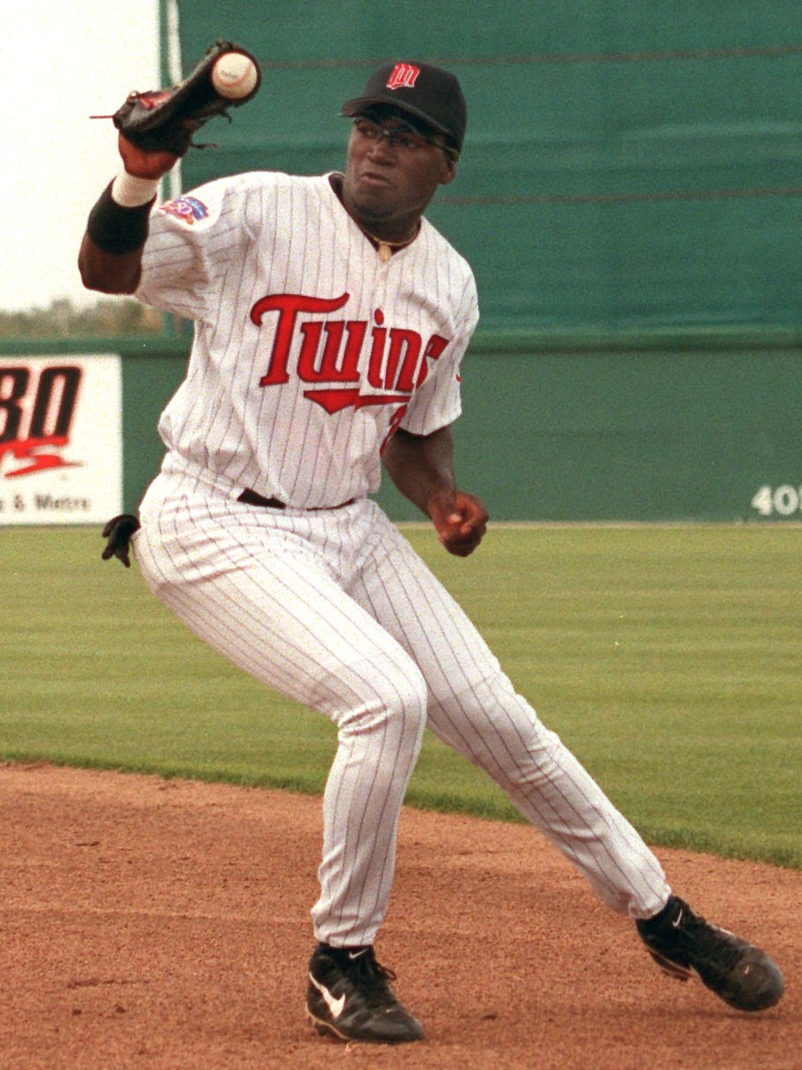 David Ortiz fields a ground ball at Hammond Stadium as a first baseman for the Minnesota Twins iduring spring training n 1999.
