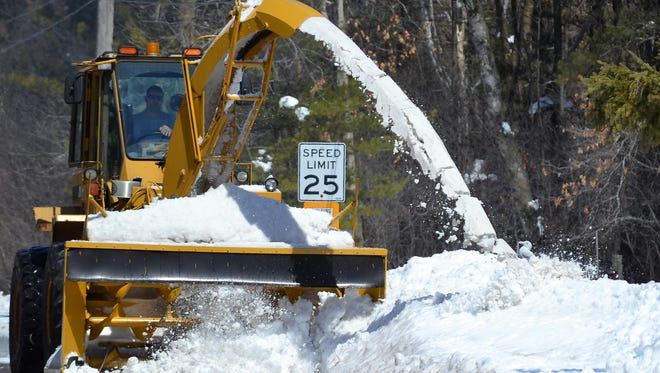 A city of Oconto operator blows snow off Superior Avenue on April 19, three days after the end of the blizzard that dropped about 29 inches of snow in the Oconto area.