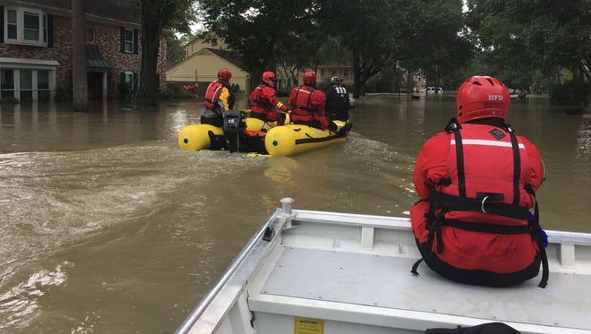 Members of a Tennessee task force work rescue missions in Houston, which was flooded from historic rains due to Hurricane Harvey.
