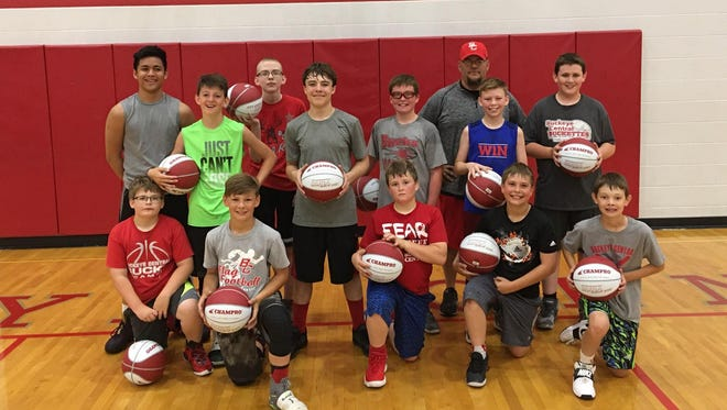 Eric Picklesimer and the Buckeye Central seventh and eighth grade teams at their summer camp.