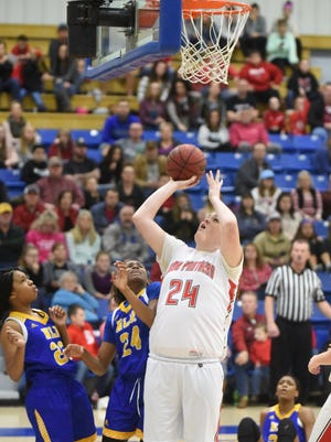 Norfork's Hannah Bryant goes up for two during the Lady Panthers' 72-50 loss to North Little Rock on Friday night in the championship game of the 1st Arkansas Bail Bonds Tournament at The Hangar.