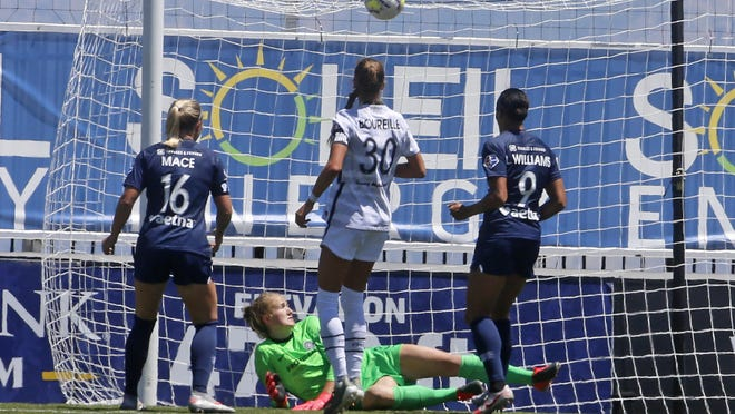 Portland Thorns FC goalkeeper Bella Bixby looks on as North Carolina Courage forward Lynn Williams (9) scores against her during the second half of an NWSL Challenge Cup soccer match at Zions Bank Stadium on Saturday in Herriman, Utah.