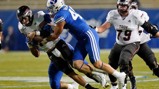 BYU linebacker Payton Wilgar (49) sacks Troy quarterback Gunnar Watson, left, during the second half of an NCAA college football game, September 2020 in Provo, Utah. (AP Photo/Rick Bowmer, Pool)