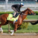 Gun Runner, with jockey Florent Geroux, teamed with a stable mate during an April 25 workout at Churchill Downs.