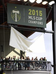 The 2015 MLS Cup Champions banner was unveiled prior to the MLS soccer match in Portland, Ore., Sunday, March 6, 2016. (AP Photo/Steve Dipaola)