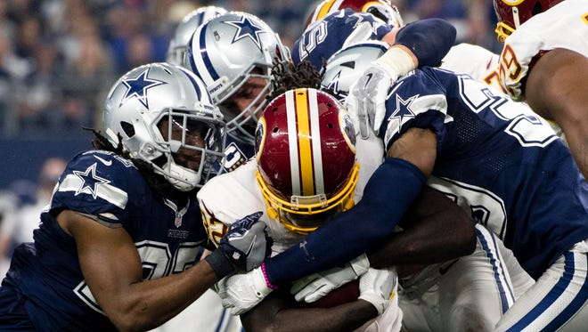 The Cowboys defense slowed the Redskins just enough Thursday.