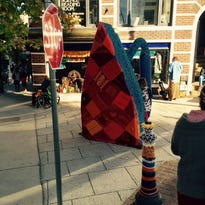 The yarn installation on the Flat Iron sculpture was up for three weeks, coming down Monday.