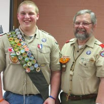 Eagle Scout Andrew Rutschow, at left, smiles proudly after being awarded the Eagle Scout award by Scout Master Rick Ormand.