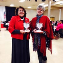Yvonne Normand, left, and Suzy Lemoine with Women With Heart awards during a last year's Valentine's Day awards luncheon hosted by the St. Landry- Evangeline United Way's Women's Leadership Council. The council is holding a recruiting event for interested new members.