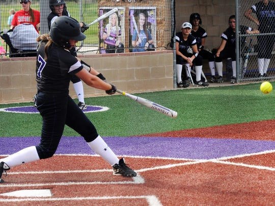 Wylie catcher Minely Avila (7) hits a single during the Lady Bulldogs' 6-5 win against Sweetwater in the District 5-4A finale on Tuesday, April 17, 2018.