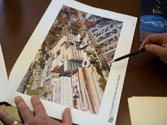 Keith Altshuler, president and chief administrative officer of Covenant Health's Fort Sanders Regional Medical Center, points to a rendering of a proposed expansion project at Fort Sanders, while at the Covenant Health corporate office on the Fort Sanders West campus Thursday, April 5, 2018. The plan calls for moving and expanding the emergency department and critical-care units, as well as remodeling some older parts of the hospital.