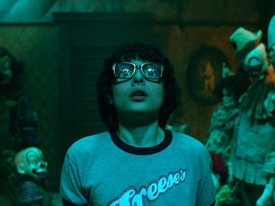 "Finn Wolfhard in a scene from ""It.""  The movie is playing"