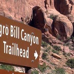 This undated photo shows a sign at the entrance of the Negro Bill Canyon Trailhead in Moab. The renewed national scrutiny of the Confederate flag has officials again considering changing the name of Utah's Negro Bill Canyon, though the title that some find offensive is a point of historical pride for others.