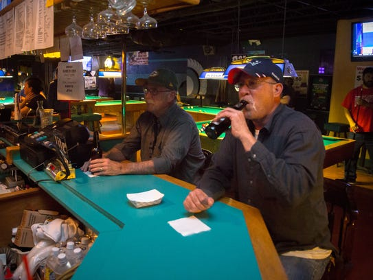 Dave Coshenet, left, and Bob Mitchell have a drink