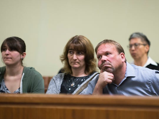 """David """"DJ"""" Creato Jr.'s father David Creato, right, and mother Lisa Creato, center, look on as their son appears in court Wednesday in Camden."""