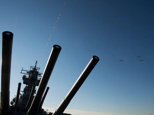 Three World War II era planes soar over the USS New Jersey during a fly over honoring the 76th anniversary of the attack on Pearl Harbor Thursday, Dec. 7, 2017 in Camden.