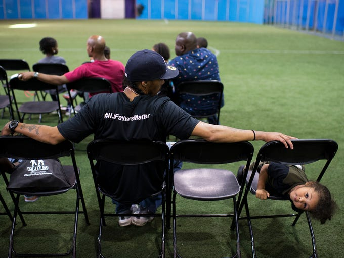 Michael Love, left, sits with his stepson Jayvon Green,