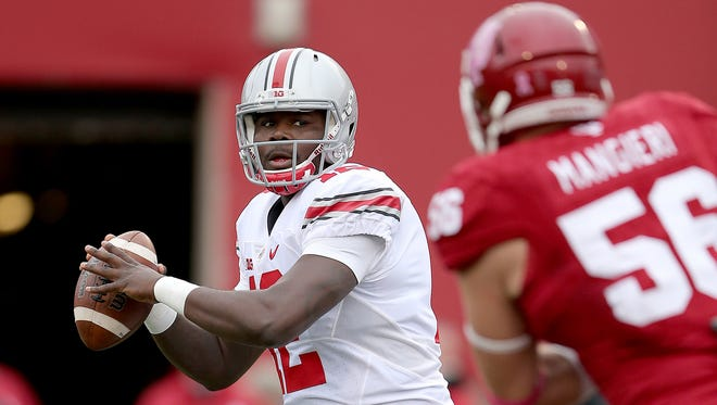 Oct 3, 2015; Bloomington, IN, USA; Ohio State Buckeyes quarterback Cardale Jones (12) passes on the Indiana Hoosiers defense in the first half of their game at Memorial Stadium. Mandatory Credit: Matt Kryger-USA TODAY Sports