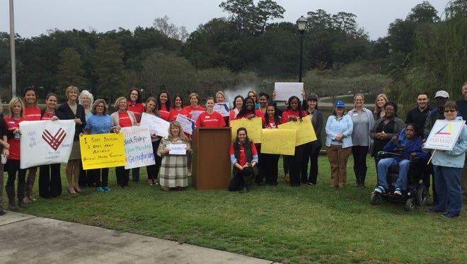 Representatives from a number of nonprofits gathered to kick off the #BigBendGivesBack campaign Monday at Lake Ella.