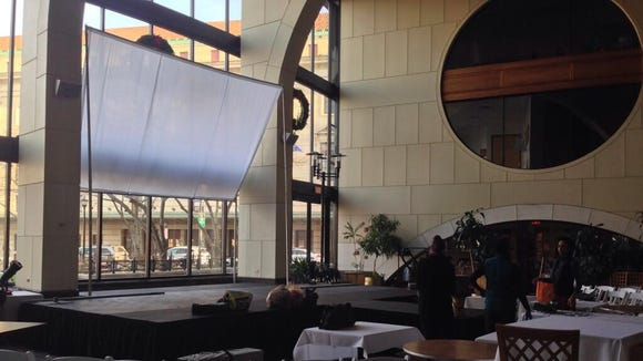 FuturFete creative team setting up stage and screen for projection at Max of Eastman Place Atrium.