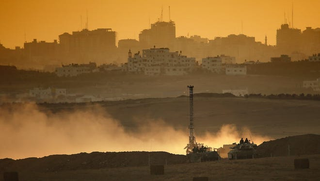 Israeli soldiers use heavy equipment to dig down and destroy the Hamas tunnels at the Israeli-Gaza border on August 3.
