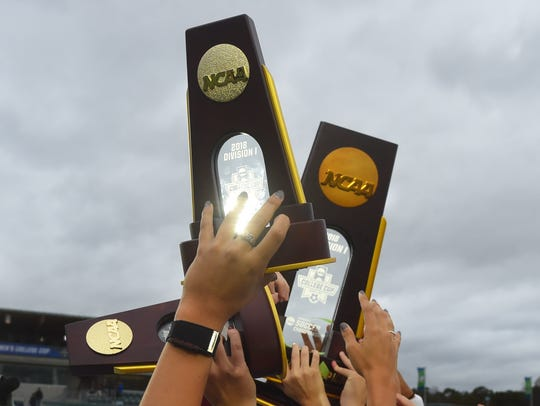 Florida State Seminoles players hold up their trophies