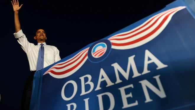 Then-Democratic presidential candidate Barack Obama waves to a crowd of supporters at a rally at the Liberty Memorial in Kansas City, Mo., Saturday, Oct. 18, 2008 where some nearly 75,000 supporters attended.