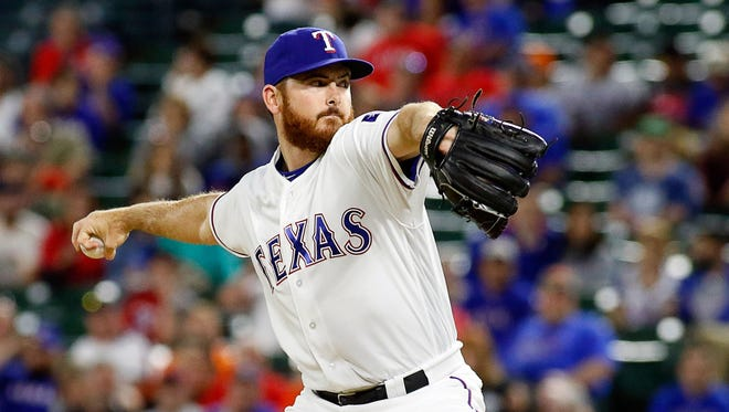 Apr 14, 2016; Arlington, TX, USA; Texas Rangers relief pitcher Sam Dyson (47) pitches against the Baltimore Orioles at Globe Life Park in Arlington. Rangers won 6-3. Mandatory Credit: Ray Carlin-USA TODAY Sports