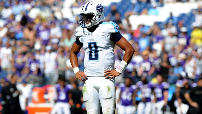 Titans quarterback Marcus Mariota (8) shows his frustration late in the fourth quarter Sunday.