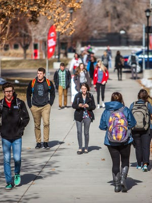Southern Utah students make their way across campus between classes, Friday, Jan. 22, 2016.