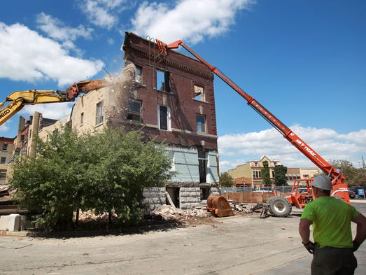 The demolition of the historic Hotel Menasha on July 24, 2014, in Menasha, Wis.  Wm.Glasheen/Post-Crescent Media