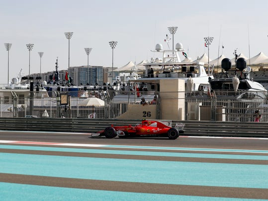 Ferrari driver Kimi Raikkonen of Finland steers his car during the first free practice at the Yas Marina racetrack in Abu Dhabi, United Arab Emirates, Friday, Nov. 24, 2017. The Emirates Formula One Grand Prix will take place on Sunday. (AP Photo/Hassan Ammar)