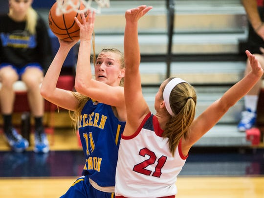 Northern Lebanon's Megan Brandt, the tournament MVP, drives to the hoop against  New Oxford's Kaelyn Long.