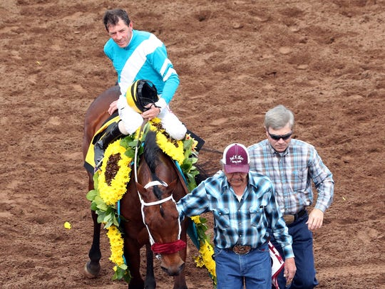 Jockey Ken S. Tohill rides into the winner's circle on Blamed after they came in first in the 18th running of the Sunland Park Oaks on Sunday, March 25, 2018 at Sunland Park, New Mexico.