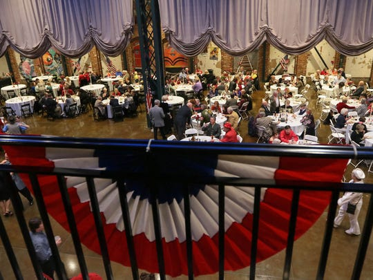 People eat Saturday while others dance to the music of the Electric City Big Band at the GAMAC USO Sweetheart's Dance at The Bleckley Station in downtown Anderson.