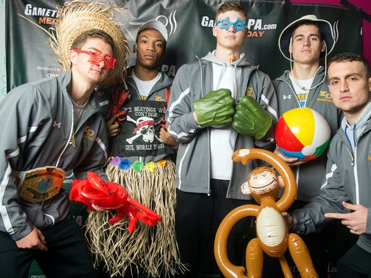 Kennard-Dale boys basketball players Adam Freese, Craig Potts, Donnell Williams, Joey Thomas and coach Jake Roupe, November 11, 2017. Teams from around the YAIAA had fun posing with props for GameTimePa's photo booth.