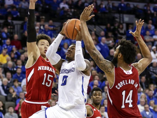 Creighton's Marcus Foster (0) goes to the basket between
