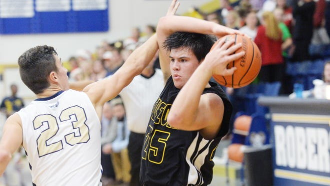 Tuscola's Grayson Perkins looks to pass as Roberson's Davis Phillips defends Wednesday night in Skyland.