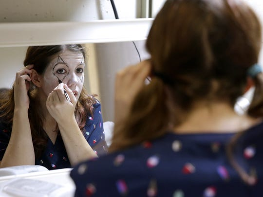 Katie Schroeder, actor in the new Gags' Nightmare: A Haunting Experience in downtown Green Bay, applies clown makeup before opening night on Oct. 4, 2017. Sarah Kloepping/USA TODAY NETWORK-Wisconsin