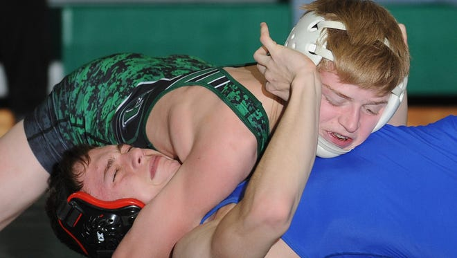 Camden Catholic freshman Cody Walsh, shown here pinning  Paul VI's Joe Frasca at 120 pounds in January, is one local youngster who's adjusted well to postseason competiion.