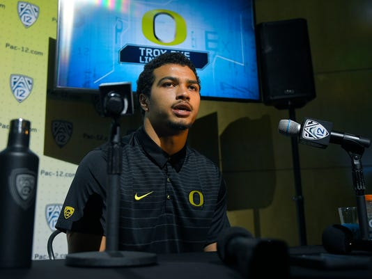 Oregon linebacker Troy Dye speaks at the Pac-12 NCAA college football media day, Thursday, July 27, 2017, in the Hollywood section of Los Angeles. (AP Photo/Mark J. Terrill)